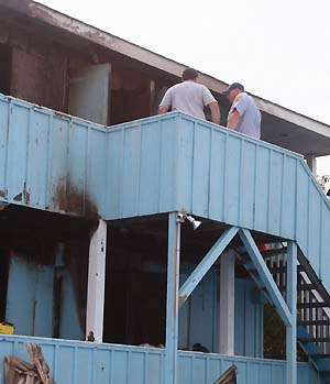 inspecting the hotel fire damage - photo by Bruce-Michael Gelbert